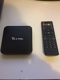 black Android box TX3 Pro with remote and wires that come with the box 543 km