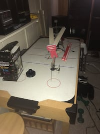 Air hockey table with 6 pucks and 2 paddles  Douro-Dummer, K9L 1G7