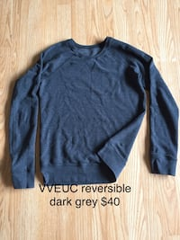 dark gray crew-neck sweater with text overlay Kelowna, V1X 1S3