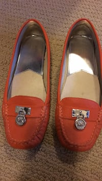 Pair of orange leather loafers Calgary, T3L 2Z6