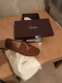 unpaired brown leather loafer with box