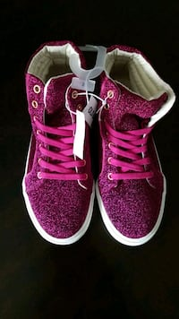 pair of pink-and-black Nike sneakers Odessa, 79762