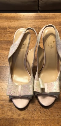Pair of beige peep-toe heeled shoes