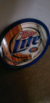 white and blue Miller Lite neon signage null