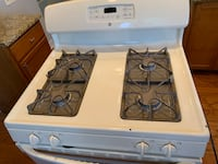 white and black gas range oven null