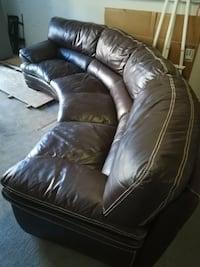 Round sectional leather couch Laval, H7Y 1M1