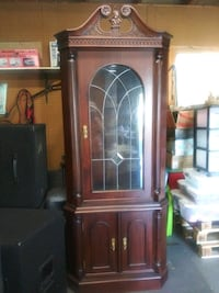 brown wooden framed glass display cabinet Chesapeake, 23324