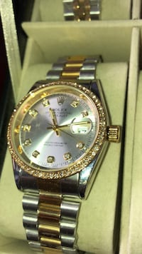 round gold Rolex analog watch with link bracelet Brampton, L6P 2R1