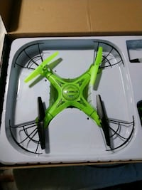 green and black quadcopter drone with box