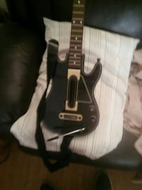 black and white electric guitar game controller