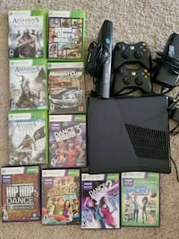 Xbox 360 console with controllers and game cases Fishers, 46038