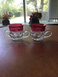 Two red and white tea cups
