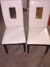 2 white leather high back chairs