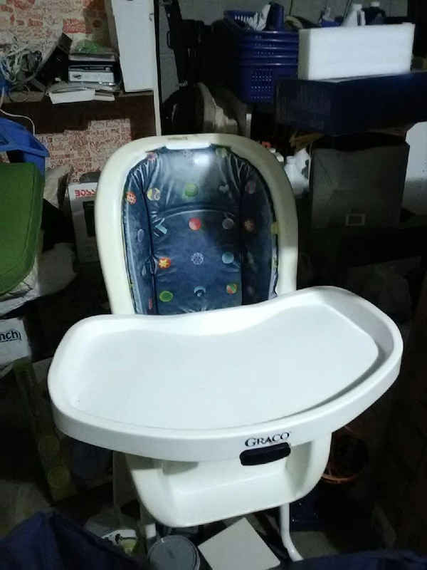 baby's white and blue Graco highchair