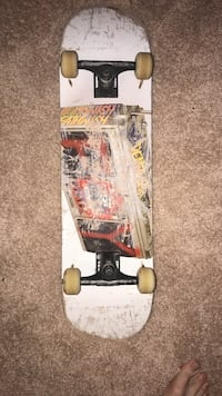 red, brown, and white skateboard Mobile, 36605
