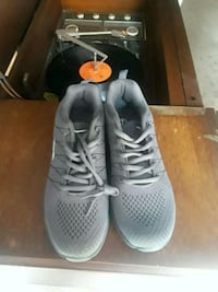 pair of gray Nike running shoes Union City, 07087