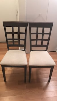 2 black wooden frame with white pad chairs New York, 10019