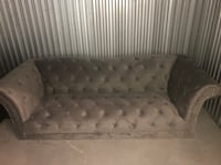 Fairly New Gray Sofa (Pillows are included) 22 km