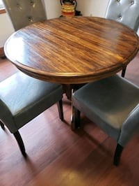 round brown wooden table with four chairs dining s New Carlisle, 46552