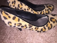 Pair of leopard print heeled shoes new