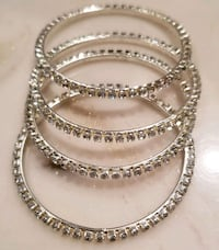 4 peice silver-colored baby bangles  556 km