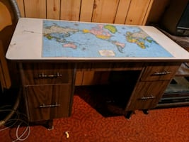 Desk with world map surface