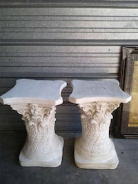 two white floral stone side tables