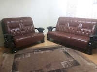 tufted brown leather loveseat with black wooden base Toronto, M2J 3S4