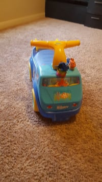 blue and yellow ride-on car toy