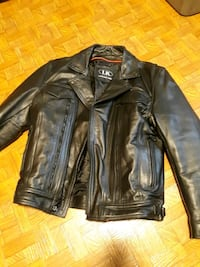 Heavy leather motorcycle jacket. $75. Medium
