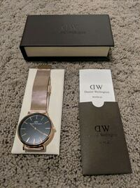 round silver analog watch with brown leather strap in box Calgary, T2T
