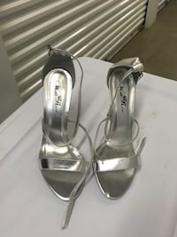 pair of silver-colored open-toe heels Palm Springs, 33461