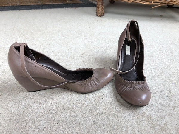 pair of gray leather peep-toe heeled shoes 2