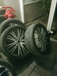 four black and gray car wheels