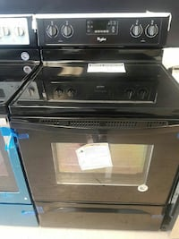 black Whirlpool soft-top range oven