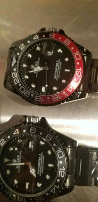 round black and red chronograph watch with link bracelet 535 km