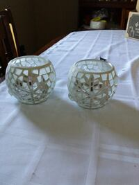 two round white glass candle holders