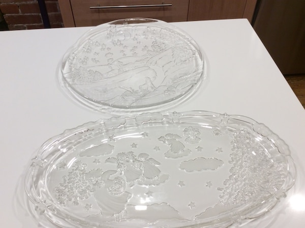 two round and oval clear cut glass plates
