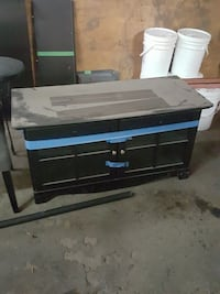 black and blue wooden TV stand