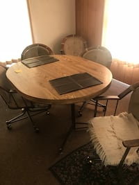 round brown wooden table with four chairs Eugene, 97405