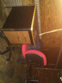 Metal and wood office dest and rolling chair $80 Pine Lake, T0M 1S0