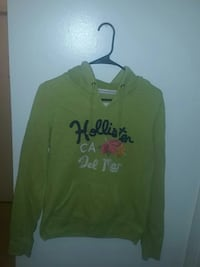 green and black Hollister pullover hoodie
