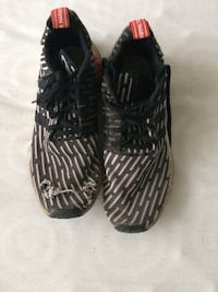 Pair of black-and-white adidas nmds shoes size 10 Burnaby, V5H 4N4