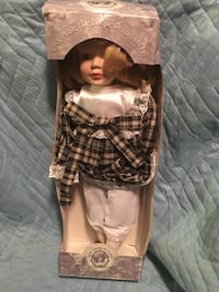 porcelain doll in brown and white dress Dartmouth, B3A 1M6