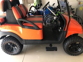 Orange and black golf cart.  Great condition.