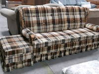 Brown plaid sofabed and ottoman 459 km