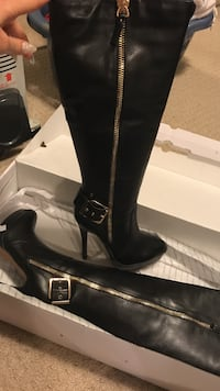 pair of black leather side-zip almond-toe stiletto knee-high boots with white box Edmonton, T6R 3R6