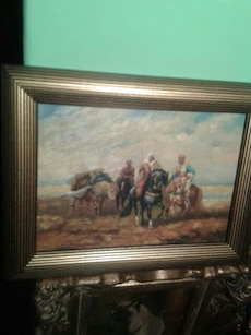 people riding on horses painting