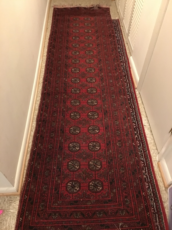 Red and brown runner rug