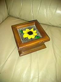 brown wooden framed painting of yellow petaled flower